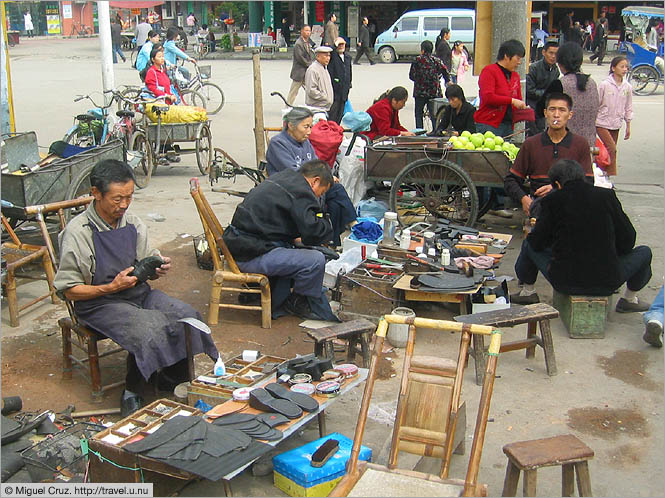 China: Sichuan Province: Streetside shoe repair