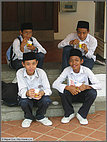 Snacking Malay schoolboys